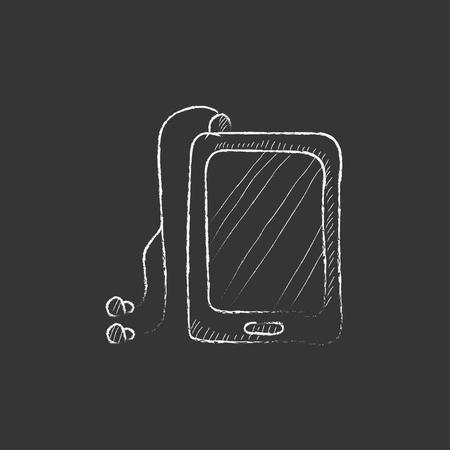 Tablet with headphones. Hand drawn in chalk vector isolated icon for web, mobile and infographics.