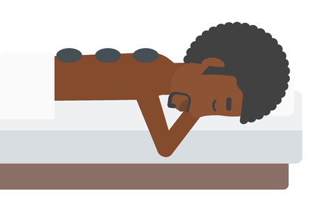 An african-american man relaxing while getting stone therapy massage vector flat design illustration isolated on white background. Vettoriali