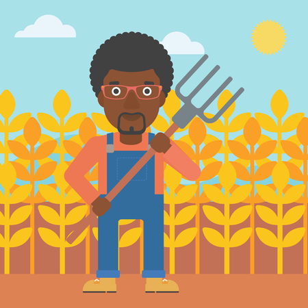 An african-american man standing with a pitchfork on the background of wheat field vector flat design illustration. Square layout.