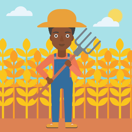 An african-american woman standing with a pitchfork on the background of wheat field vector flat design illustration. Square layout.