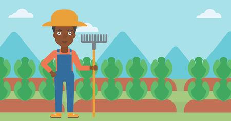 agrarian: An african-american woman standing with a rake on the background of cabbage field vector flat design illustration. Horizontal layout. Illustration