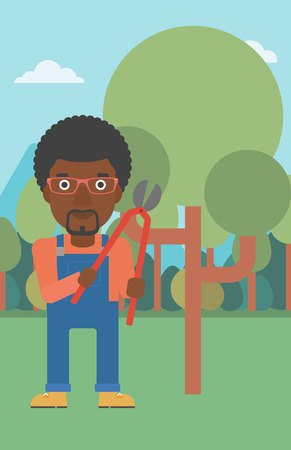 pruner: An african-american man holding a pruner on a background of garden with trees vector flat design illustration. Vertical layout.
