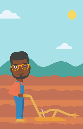 An african-american man using a plough on the background of plowed agricultural field vector flat design illustration. Vertical layout.