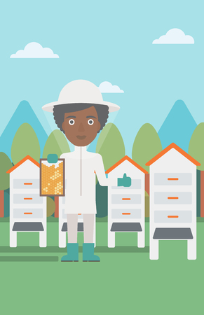 An african-american  woman wearing protective suit holding a framework in hand and showing thumb up on the background of apiary vector flat design illustration. Vertical layout.