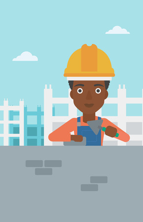 brick and mortar: An african-american female bricklayer with a spatula and a brick in hands on a background of construction site vector flat design illustration. Vertical layout. Illustration