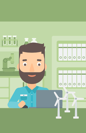 A hipster man with the beard sitting at the table with a laptop and wind turbine models vector flat design illustration. Vertical layout. Illusztráció
