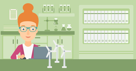 A woman sitting at the table with a laptop and wind turbine models vector flat design illustration. Horizontal layout.