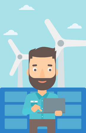 A hipster man with the beard holding a laptop in hands on a background with solar pannels and wind turbins vector flat design illustration. Vertical layout.