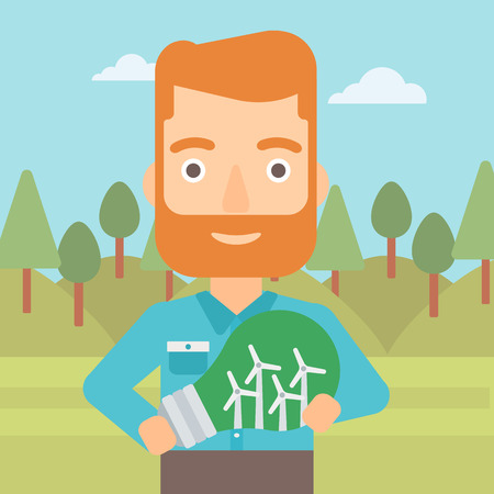 A hipster man with the beard standing on the background of green forest and holding in hands a big light bulb with small wind turbines inside vector flat design illustration. Square layout. Illustration