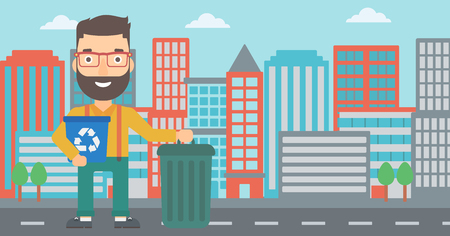 A hipster man with the beard standing with a recycle bin in hand and another bin on the ground on a city background vector flat design illustration. Horizontal layout. Illustration