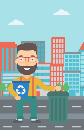 wastebasket: A hipster man with the beard standing with a recycle bin in hand and another bin on the ground on a city background vector flat design illustration. Vertical layout.