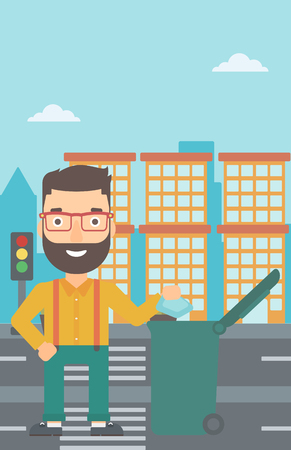 A hipster man with the beard throwing a trash into a green bin on a city background vector flat design illustration. Vertical layout.