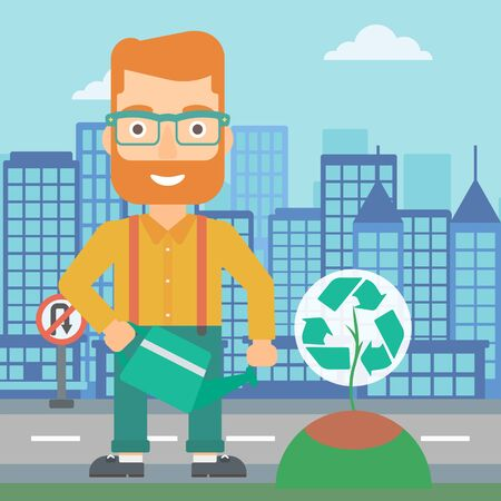 A hipster man with the beard watering a tree with a recycle sign instead of crown on a city backround vector flat design illustration. Square layout.