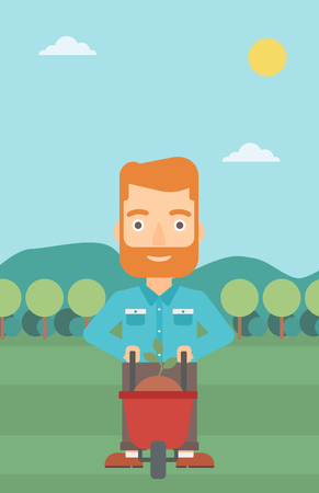 A hipster man with the beard standing with a plant and soil in a wheelbarrow on the background of mountain landscape vector flat design illustration. Vertical layout.