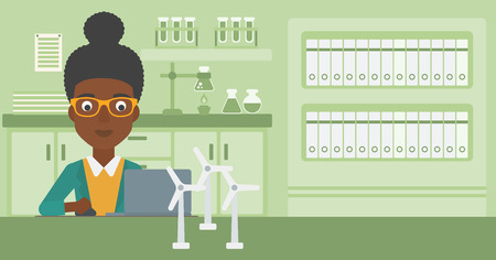 An african-american woman sitting at the table with a laptop and wind turbine models vector flat design illustration. Horizontal layout.