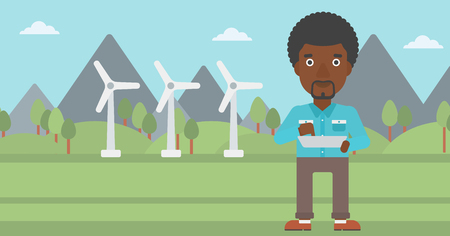 An african-american man holding a tablet computer in hands on a background with solar pannels and wind turbins vector flat design illustration. Horizontal layout.