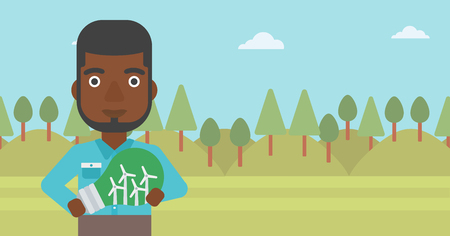 An african-american man standing on the background of green forest and holding in hands a big light bulb with small wind turbines inside vector flat design illustration. Horizontal layout.