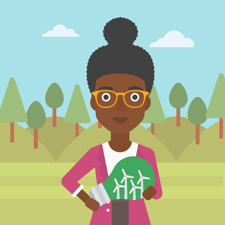 An african-american woman standing on the background of green forest and holding in hands a big light bulb with small wind turbines inside vector flat design illustration. Square layout.