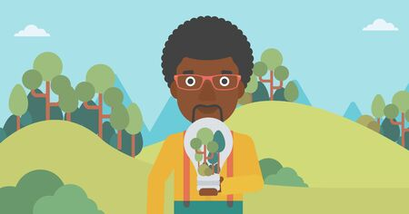An african-american man standing on the background of green forest and holding in hands a big lightbulb with trees inside vector flat design illustration. Horizontal layout.