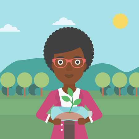 small plant: An african-american woman standing on the background of mountain landscape and holding in hands a plastic bottle with a small plant growing inside vector flat design illustration. Square layout. Illustration
