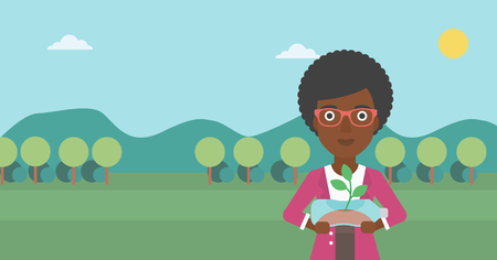 growing inside: An african-american woman standing on the background of mountain landscape and holding in hands a plastic bottle with a small plant growing inside vector flat design illustration. Horizontal layout.