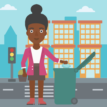 An african-american woman throwing a trash into a green bin on a city background vector flat design illustration. Square layout. Vettoriali
