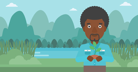 hands holding plant: An african-american man holding in hands a small plant in soil on the background of landscape with mountains and river vector flat design illustration. Horizontal layout.
