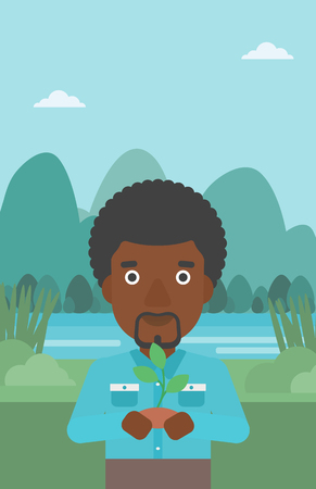 small plant: An african-american man holding in hands a small plant in soil on the background of landscape with mountains and river vector flat design illustration. Vertical layout.