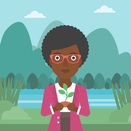 An african-american woman holding in hands a small plant in soil on the background of landscape with mountains and river vector flat design illustration. Square layout. Illustration