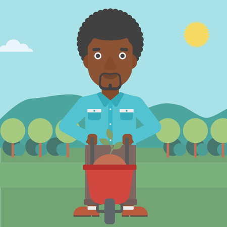 An african-american man standing with a plant and soil in a wheelbarrow on the background of mountain landscape vector flat design illustration. Square layout.