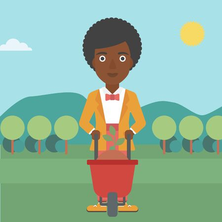 flat earth: An african-american woman standing with a plant and soil in a wheelbarrow on the background of mountain landscape vector flat design illustration. Square layout. Illustration