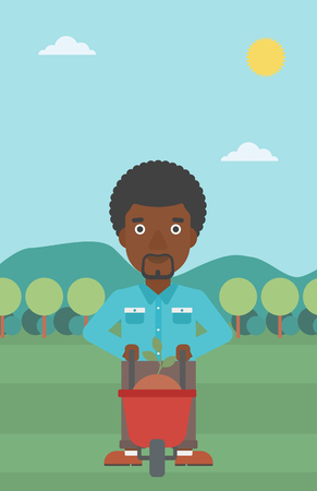 An african-american man standing with a plant and soil in a wheelbarrow on the background of mountain landscape vector flat design illustration. Vertical layout. Illustration