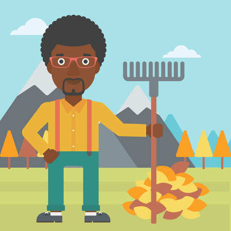 An african-american man with rake standing near heap of autumn leaves on the background of mountain landscape vector flat design illustration. Square layout.