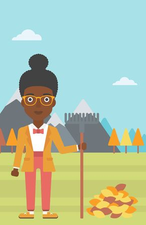 autumn woman: An african-american woman with rake standing near heap of autumn leaves on the background of mountain landscape vector flat design illustration. Vertical layout. Illustration