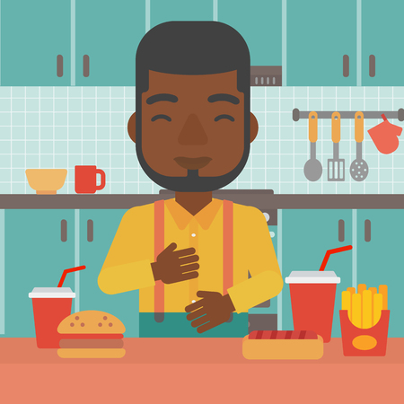 An african-american man standing in the kitchen in front of table full of junk food and suffering from heartburn vector flat design illustration. Square layout. Ilustrace