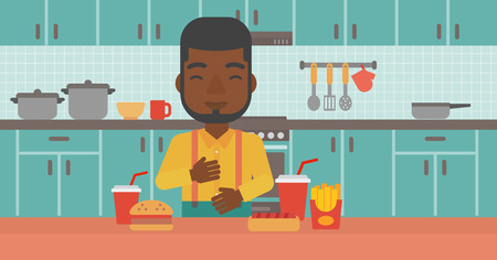 fire in the belly: An african-american man standing in the kitchen in front of table full of junk food and suffering from heartburn vector flat design illustration. Horizontal layout. Illustration