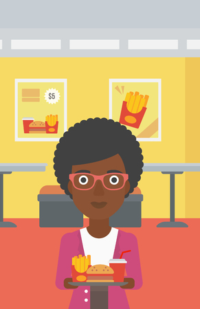 french ethnicity: An african-american woman holding a tray full of junk food on a cafe background vector flat design illustration. Vertical layout.