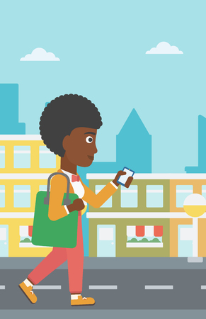 smart phone woman: An african-american woman walking with a smartphone on a city background vector flat design illustration. Vertical layout.