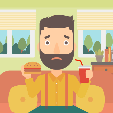 A hipster man with the beard sitting on a sofa while eating hamburger and drinking soda on the background of living room vector flat design illustration. Square layout.