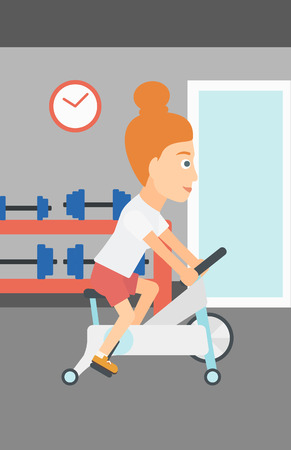 woman exercising: A woman exercising on stationary training bicycle in the gym vector flat design illustration. Vertical layout.