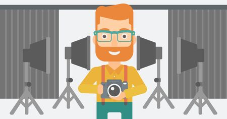 lighting equipment: A hipster man with the beard holding a camera on the background of photo studio with lighting equipment vector flat design illustration. Horizontal layout.