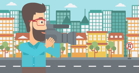 cinematograph: A hipster cameraman with video camera taking a video on a city background vector flat design illustration. Horizontal layout.