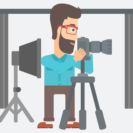 snapshot: A hipster photographer with the beard working with camera on the background of photo studio with lighting equipment vector flat design illustration. Square layout.