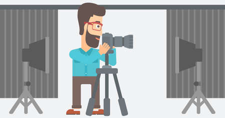 lighting equipment: A hipster photographer with the beard working with camera on the background of photo studio with lighting equipment vector flat design illustration. Horizontal layout.