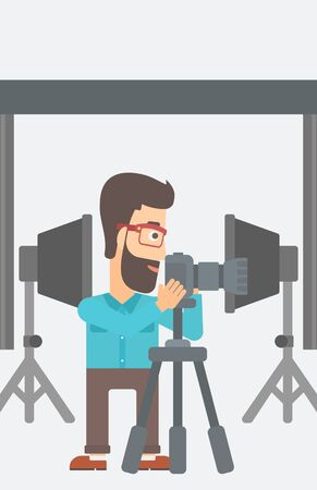 A hipster photographer with the beard working with camera on the background of photo studio with lighting equipment vector flat design illustration. Vertical layout.