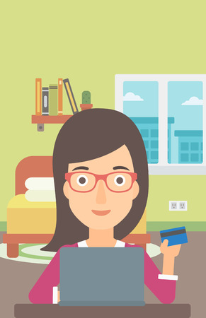 woman credit card: A woman sitting in front of laptop with credit card in hand and making purchases online on the background of bedroom vector flat design illustration. Vertical layout.