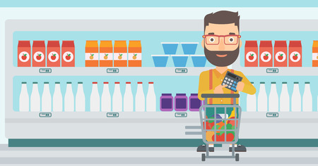 A hipster man with the beard standing near shopping cart and holding a calculator in hands on the background of supermarket shelves with products vector flat design illustration. Horizontal layout. Illustration