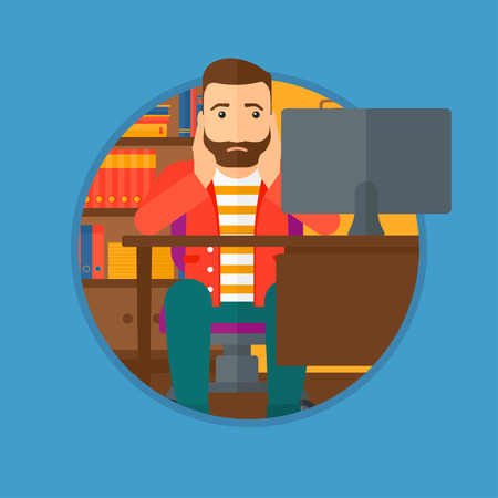 A tired hipster man with the beard sitting at workplace in front of computer monitor and clutching his head. Vector flat design illustration in the circle isolated on light blue background.