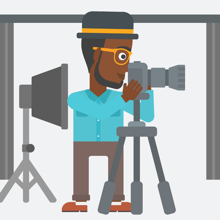 An african-american photographer working with camera on the background of photo studio with lighting equipment vector flat design illustration. Square layout. 向量圖像