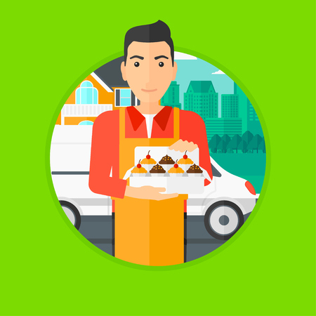 cupcakes isolated: A baker holding a box of cakes. A baker delivering cakes. A baker with cupcakes standing on the background of delivery truck. Vector flat design illustration in the circle isolated on background. Illustration